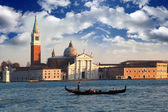 Venice with gondolier, San Giorgio Maggiore church in Italy — Stock Photo