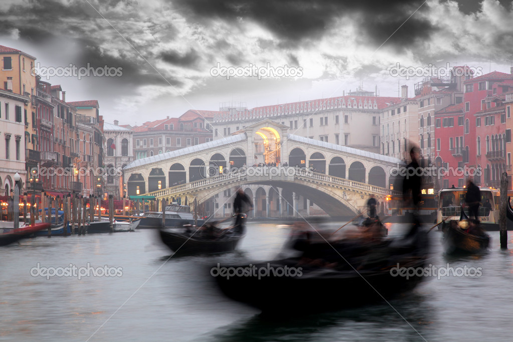 Venice, Rialto bridge with gondola in Italy  Stock Photo #11274835