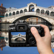 Venice, Rialto bridge with gondola in Italy — Stock Photo