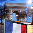 Paris, Famous Arc de Triumph at evening , France - Stock Photo