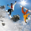 Snowboarder jumping against blue sky — Stock Photo #12264189