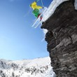 Skier jumping though the air from the cliff — Stock Photo #12265317