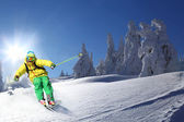 Skier skiing downhill in high mountains — Stok fotoğraf