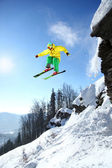 Skier jumping though the air from the cliff — Stock Photo