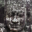 Stock Photo: Close-up of smiling face of king JayavarmVII in temple of Bayon, Angkor Wat, Siem Riep, Cambodia.