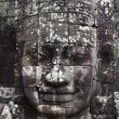 Close-up of smiling face of king JayavarmVII in temple of Bayon, Angkor Wat, Siem Riep, Cambodia. — Stock Photo #10782536
