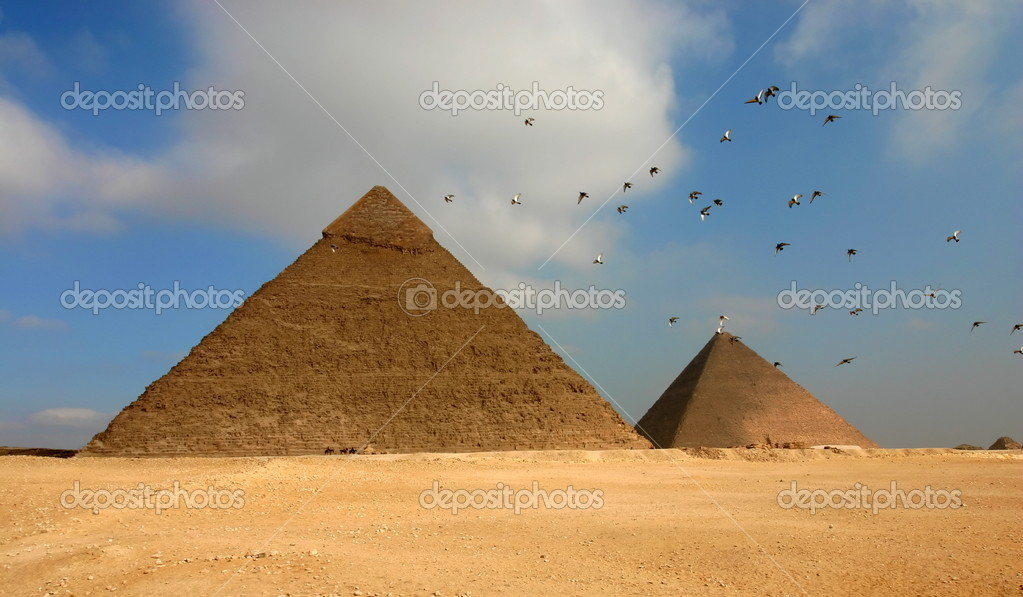Egypt Giza pyramids with flying birds on the foreground — Stock Photo #10780270