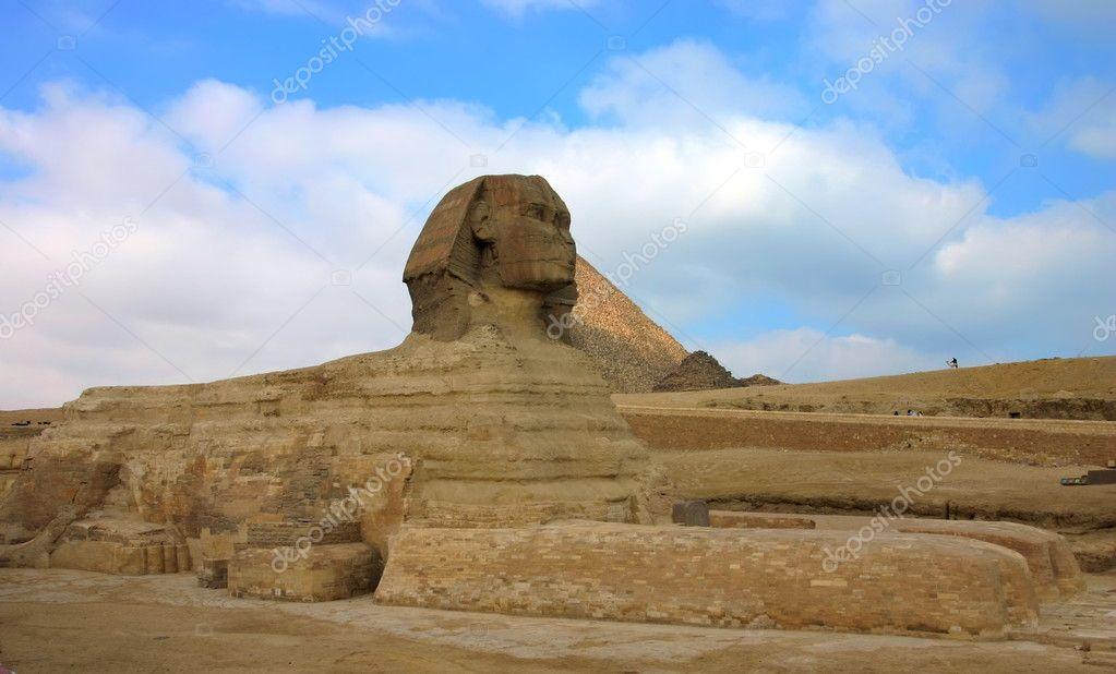 Giza sphinx with pyramids on the background. Cairo. Egypt. — Stock Photo #10780797