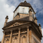 Sundial and carved stone. Cambridge. UK. — Stock Photo