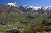 Caucasus Mountains and Stepantsminda village. Georgia. — Stock Photo