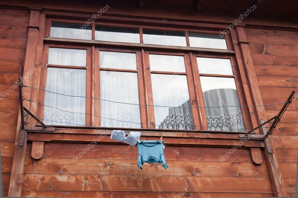 Washing line in front of a window. Tbilisi, Georgia. — Stock Photo #10792953