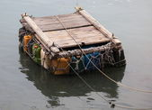 Personal pontoon ferry made from empty plastic containers. Cheung Chau. Hong Kong. — Stock Photo