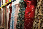 Chinese style dresses. Temple street market. Hong Kong. — Stock Photo