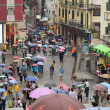 Under colourful umbrellas. Rainy day. Macau. China. — Stock Photo