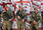 Soldiers posing in front of Georgian flag. Tbilisi. Georgia. — Stock Photo