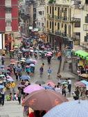 Under colourful umbrellas. Rainy day. Macau. China. — Stock Photo