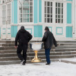 Two men carrying baptistery. Smolenk Russia — Stock Photo