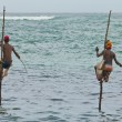 2 fishermen on sticks — Stock Photo