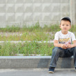 Stock Photo: Boy on curb