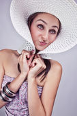 Girl in a white summer hat — Stok fotoğraf