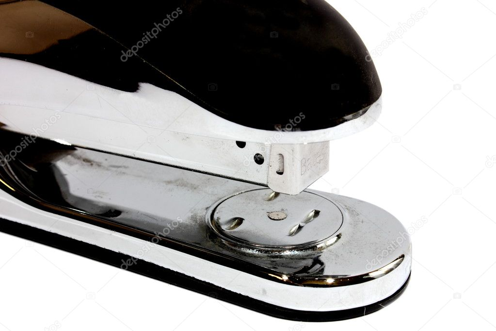 Isolated chrome and black stapler used for binding things together.  — Stock Photo #11732730
