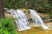 Mumlava waterfall in Harrachov in Czech Republic, next to the border with Poland — Stock Photo