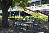 Shady backyard of a hotel in a hot sunny day — Stock Photo