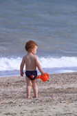 Boy on a marine beach — Stock Photo