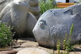 Stone sculptures of Fish and turtles — Stock Photo