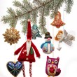 Vintage Christmas toys on fir tree branch — Stockfoto