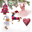Vintage Christmas toys on  fir tree branch - Stock Photo