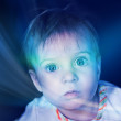 Child and mystical dark blue light - Stock Photo