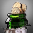 Champagne bottle and coins — Stock Photo #11312937