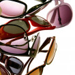 Assorted styles of tinted sunglasses — Stock Photo