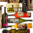 Stock Photo: Different alcohol bottles against white background