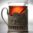 Glass of tea in a silver cup - Foto Stock