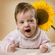 Child and sunflower - Stock Photo