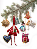 Vintage Christmas toys on fir tree branch — Zdjęcie stockowe