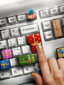 Computer keyboard with gift keys — Stock Photo