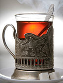 Glass of tea in a silver cup — Stock Photo