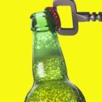 Opening beer bottle with metal opener — Stock Photo