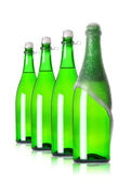 Four bottles of champagne in row — Stock Photo