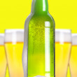 Open beer bottle with ice and foam - Stock Photo