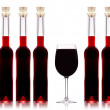 Bottles of wine and wineglass on white background - Stock Photo