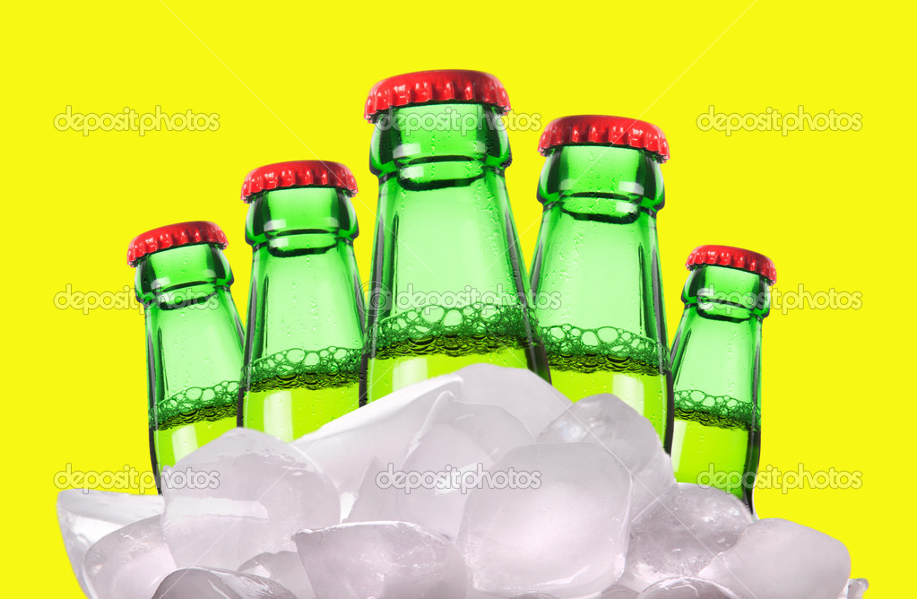 Beer bottles with ice isolated on a yellow background — Lizenzfreies Foto #11160024