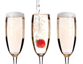 Champagne with strawberry - christmas cocktail — Stock Photo