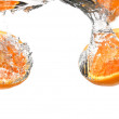 Orange plunging into cold water — Stock Photo