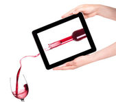 Isolated Hands Holding Digital Tablet with Red wine splashing — Stock Photo