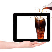 Isolated Hand Holding Digital Tablet with fresh splashing Cola. — Stock Photo