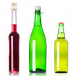 Lots bottles of various alcoholic drinks isolated — Stock Photo #11355478